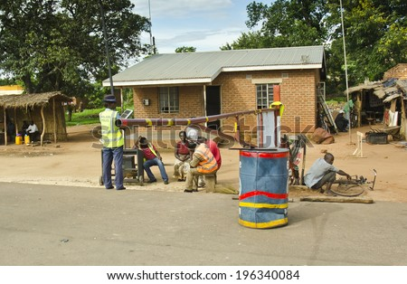 BALAKA, MALAWI - JANUARY 19: a police road block on January 19, 2014 in Balaka, Malawi. The police service of Malawi is the most corrupt public institution in the country (source: TI, 2013).  - stock photo