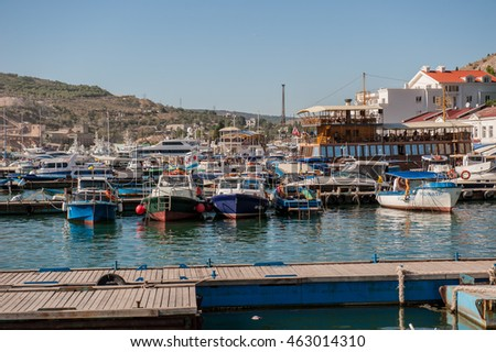 BALAKLAVA, CRIMEA. UKRAINE - JULY 25, 2010: view from the promenade of the bay and marinas with boats and yachts