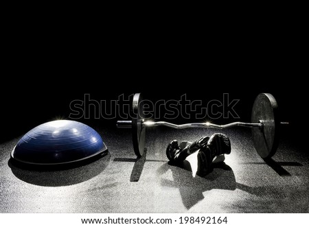 Balance Ball Boxing Gloves and Easy Curl - stock photo