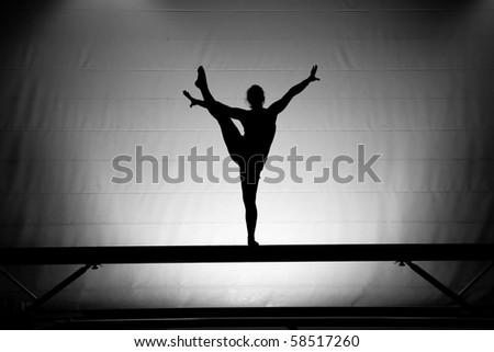 balance beam silhouette - stock photo