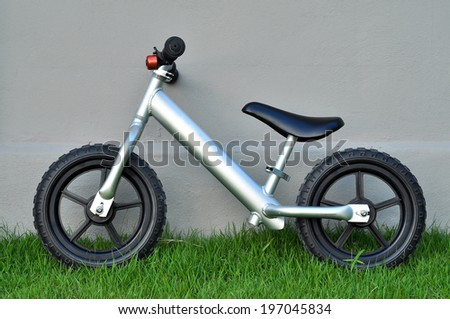Balance bicycle is a toy that gives kids practice in the skills of balance and judgment. - stock photo