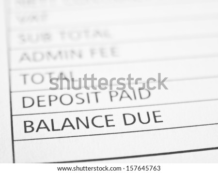 BALANCE DUE written on a form or contract close up.