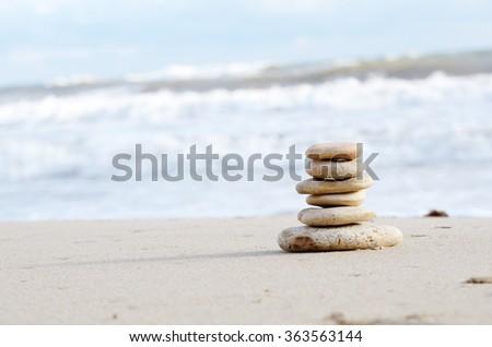 Balance or harmony concept Stack of pebbles at sea coast - stock photo