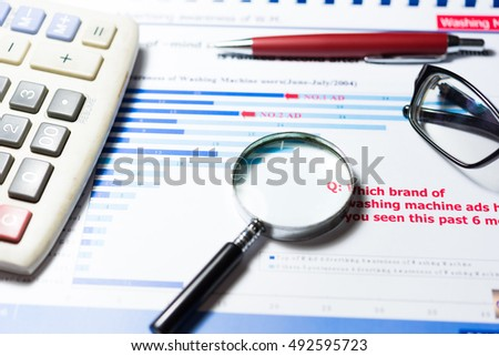 Balance sheet figures are statistics which including of pen, glasses and calculator. all information represent profit and cost. - Financial analysis concept.
