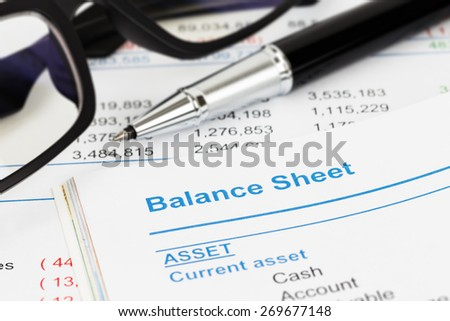 Balance sheet in stockholder report book, balance sheet is mock-up