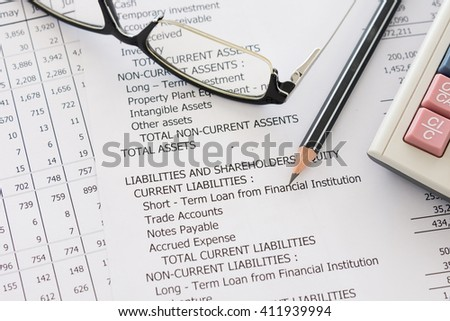 Balance sheet ,pencil, calculator,glasses on accountant's desk. Accounting , accounts concept. - stock photo