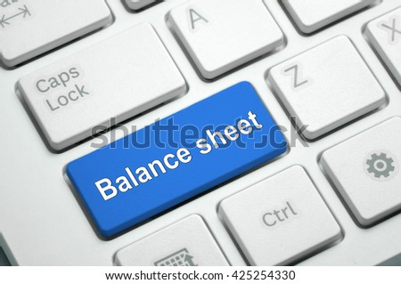 Balance sheet text written on Blue button White Keyboard