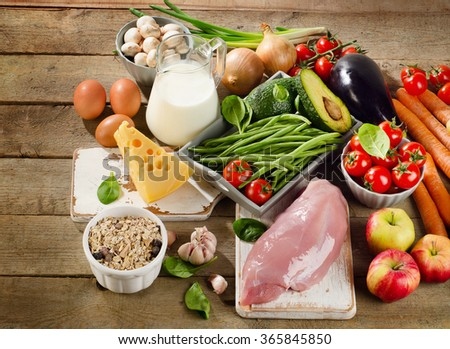 Balanced diet, cooking and organic food concept on a rustic wooden table. Top view - stock photo