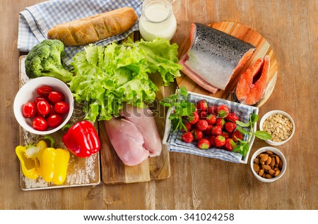 Balanced diet, healthy food concept on a wooden board. View from above - stock photo