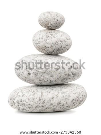 Balanced pebbles isolated on white - stock photo
