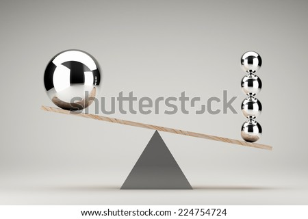 Balancing balls on wooden board conception - stock photo