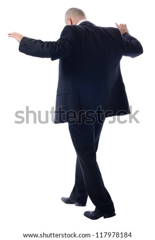 Balancing Businessman isolated on white concept of risky business