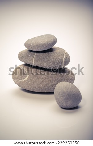 balancing stones isolated on white background. zen stones - stock photo