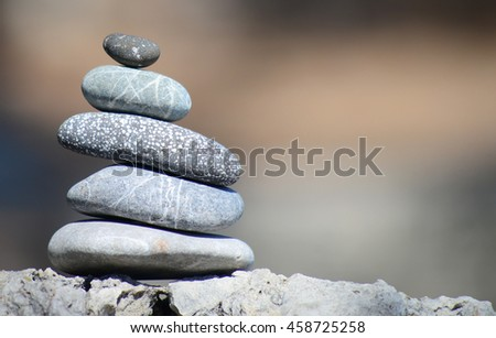 balancing stones with beautiful bokeh