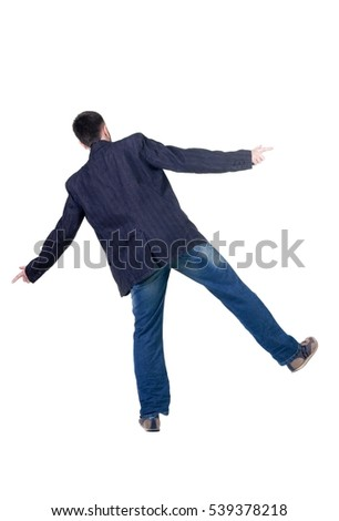 Balancing young man in jacket. Rear view. Isolated over white.
