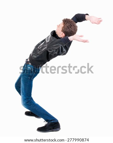 Balancing young man or dodge falling man. Rear view people collection.  backside view of person.  Isolated over white background. Man blows the wind. - stock photo