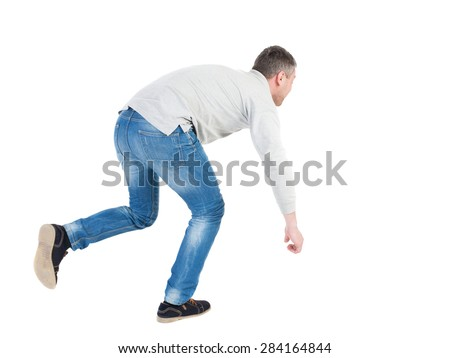 Balancing young man or dodge falling man. Rear view people collection.  backside view of person.  Isolated over white background. Man blows the wind. Running man stumbled, trying not to fall. - stock photo