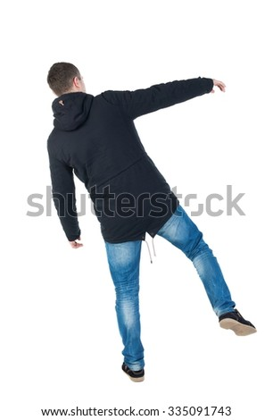 Balancing young man or dodge falling man. Rear view people collection.  backside view of person.  Isolated over white background. Man blows the wind.