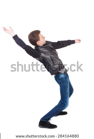 Balancing young man or dodge falling man. Rear view people collection. backside view person. Isolated over white background. Man blows the wind. guy in the leather jacket falls on his back. side view. - stock photo