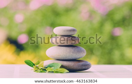 balancing zen pebble stones outdoor, spa wellness tranquil scene, soul equanimity concept, mental calmness, abstract retro colors