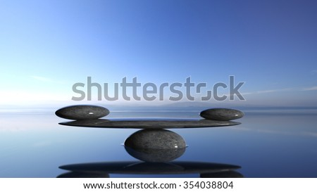 Balancing Zen stones in water with blue sky and peaceful landscape. - stock photo