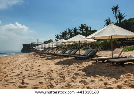 Balangan beach with parasol, Nusa Dua, is one of the most beautiful in Bali, it is called Mars at its bottom is covered with volcanic rock