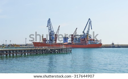 BALCHIK, BULGARIA,16.08.2015 :Big ship loading freight containers at the port of Balchik in Bulgaria