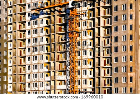 Balconies and windows of a new modern building - stock photo