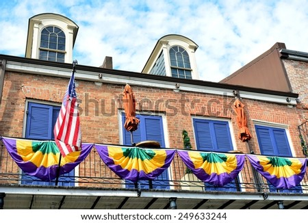 Balconies in the New Orleans French Quarter decorated for Mardi Gras. - stock photo