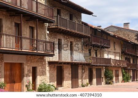 Balconies of the picturesque village of Els Hostalets, Garrotxa, Girona province, Catalonia, Spain - stock photo