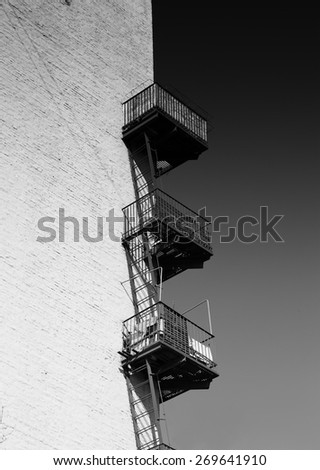 Balconies on a wall of the old building, monochrome - stock photo