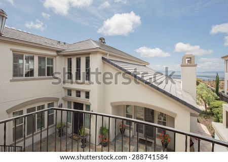 Balcony deck in Mediterranean home with courtyard. - stock photo