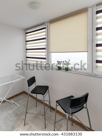 Balcony interior with windows and chairs in scandinavian style - stock photo