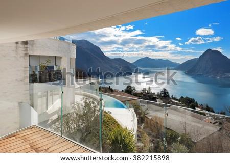 balcony of a modern penthouse, beautiful panoramic view - stock photo