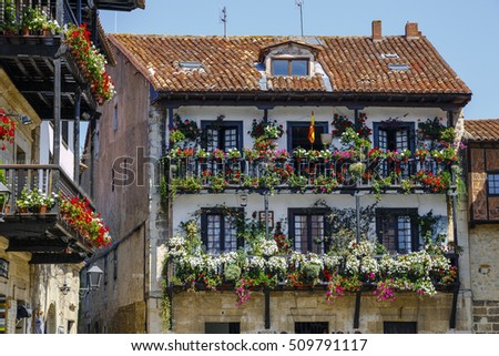 Balcony of a typical house of the medieval village of Santillana del Mar in Cantabria, Spain