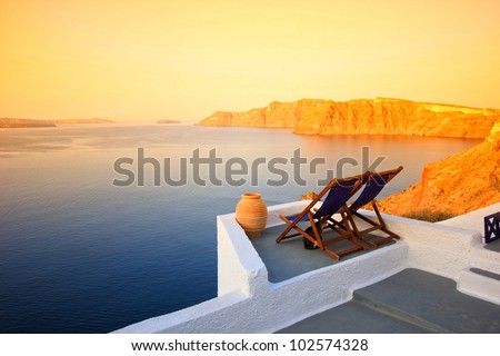 Balcony sunset over Santorini island, Greece - stock photo