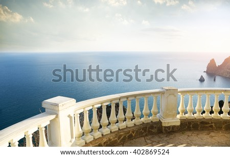 Balcony view on the ocean shore.