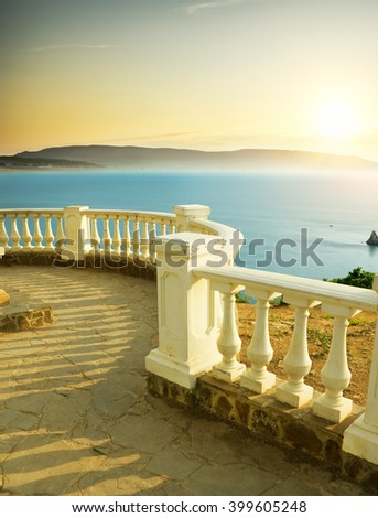 Balcony view on the sea shore on sunset