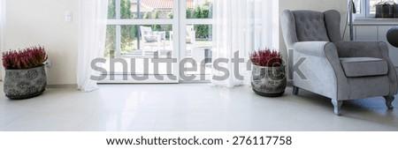 Balcony window in living room leading to garden - stock photo
