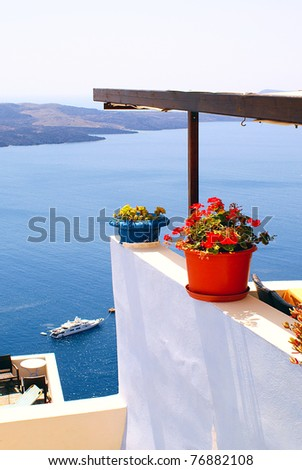 Balcony with flower on Santorini island, Greece - stock photo