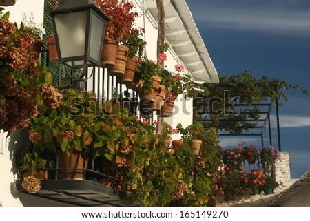 balcony with flowerpots in Capileira - Alpujarras, Spain - stock photo