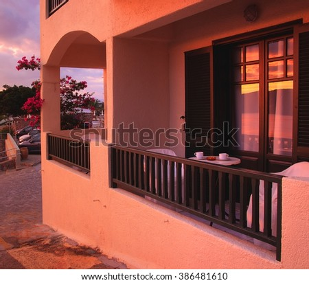 Balcony with table and chairs in the hotel. Crete, Elounda - stock photo