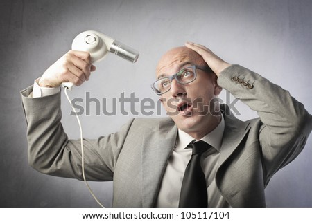 Bald businessman trying to dry his head - stock photo