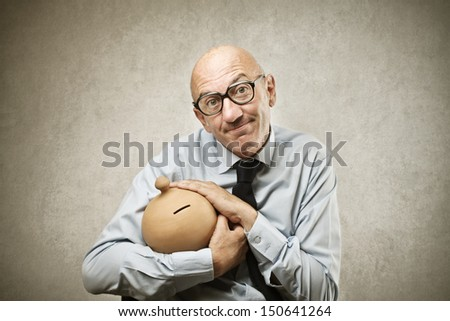 bald businessman with piggy bank - stock photo