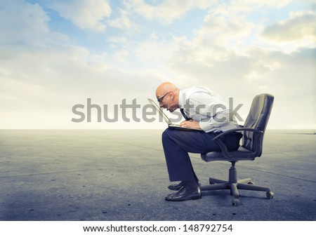 bald businessman working very focused on the computer - stock photo