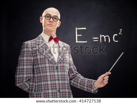bald caucasian professor or teacher with bow tie and glasses point stick on blackboard with formula - stock photo