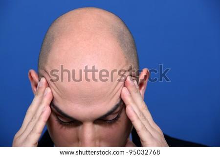 Bald executive under pressure - stock photo