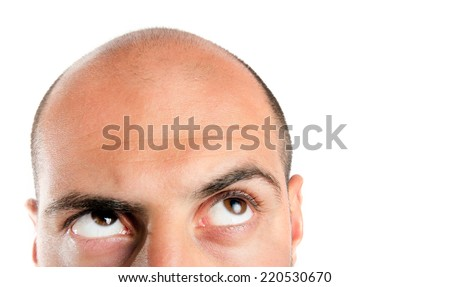 Bald guy looking up , thinking. Lots of copy space. - stock photo