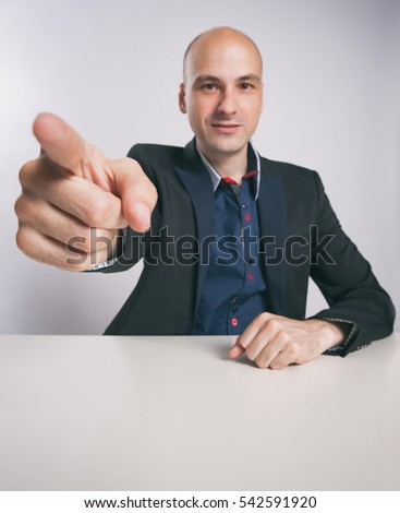 bald guy pointing finger at you