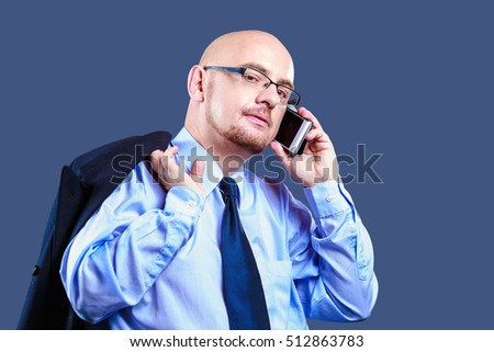 Bald headed guy with glasses making a phone call